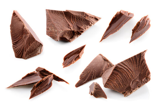 Broken chocolate pieces isolated. Chocolate chunks on white. Broken chocolate pieces set macro.