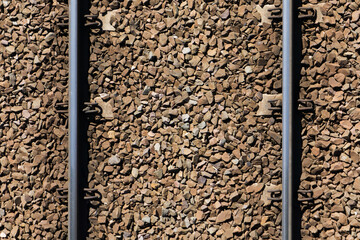 Railway top view background. Train transport industry. Rail track texture. Good and cheap way of transportation for cargo. Old railroad wooden tie. Track ballast gravel made of crushed stone.