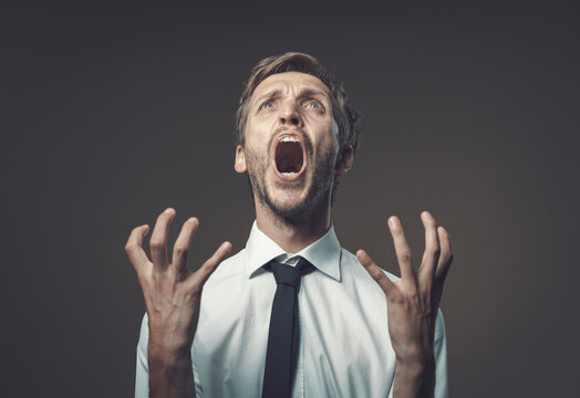 Angry stressed man shouting out loud