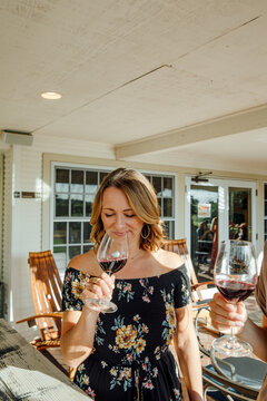 Woman Sniffs Wine at Tasting