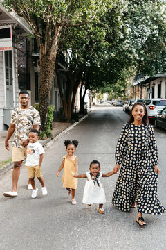 A beautiful African American family of five walking down the street in New Orleans.