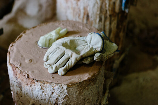 Worker gloves on a plaster block