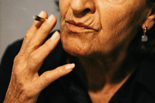 Closeup of Senior Woman Smoking CBD Joint