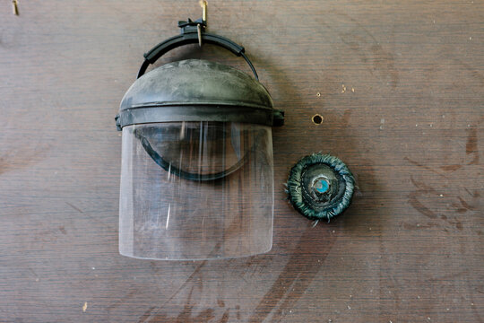 Protective helmet hanging on a wood wall