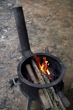 Old-fashioned stove firing, outdoor picnic party