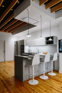Cozy modern kitchen with wooden flooring