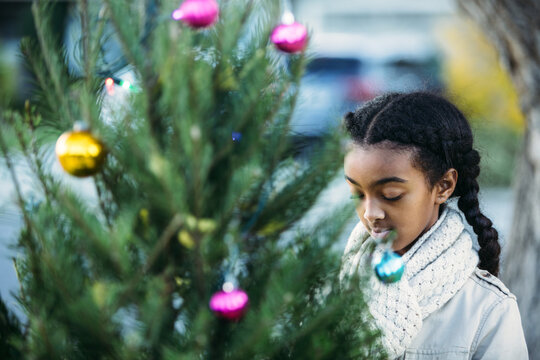 African American Girl and Christmas Tree