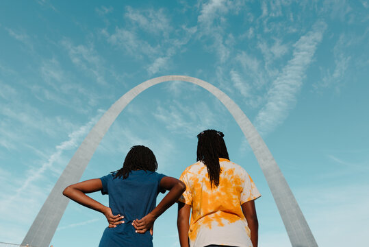 Two black girls under the St. Louis Arch