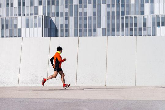 Fit senior runner in the city.