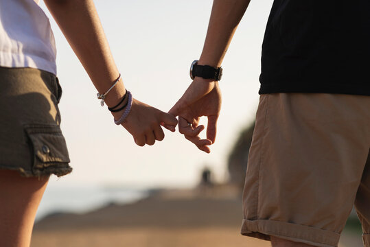 Couple holding hands on seaside