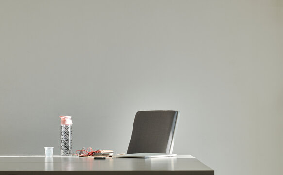 Modern office workspace with gadgets on table