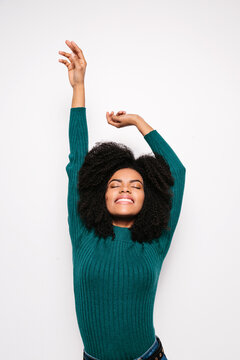 Young afro woman posing over white background
