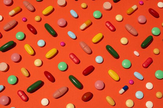 Pills against orange background