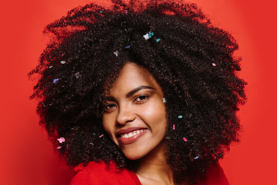 Beautiful afro woman posing over red background