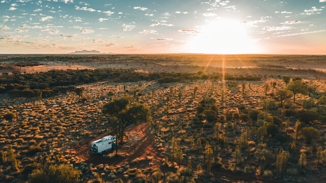 camping truck in the outback at sunrise