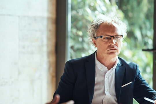 Deeply thinking businessman in glasses.