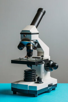 Small microscope on a blue table
