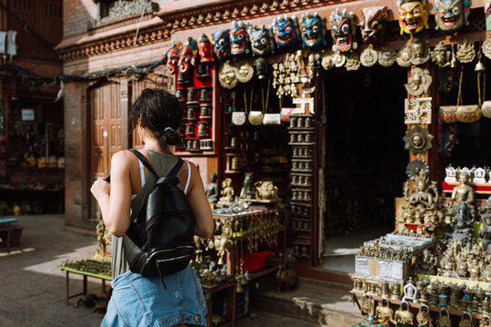 Woman near a gift shop in Swayambhunath Pagoda In Nepal
