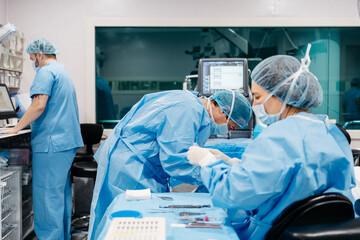 Surgeons performing eye surgery