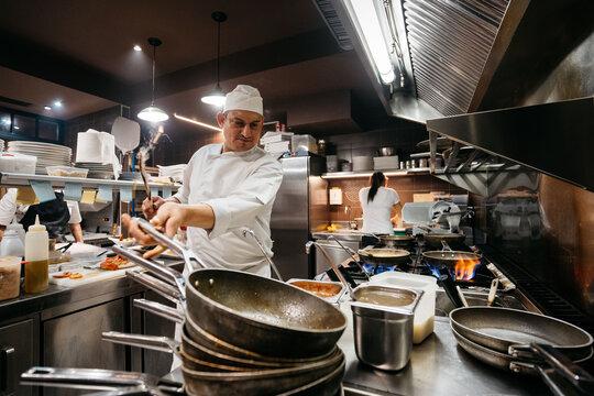 Professional chef cooking in restaurant kitchen