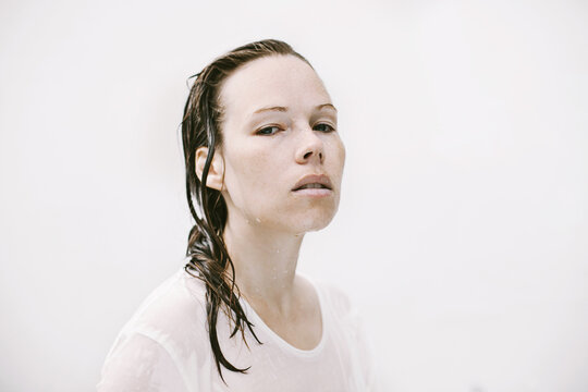 Young woman with wet hair looking straight
