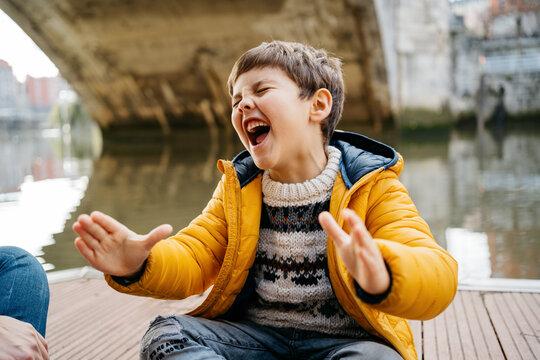 Kid singing loud at the street