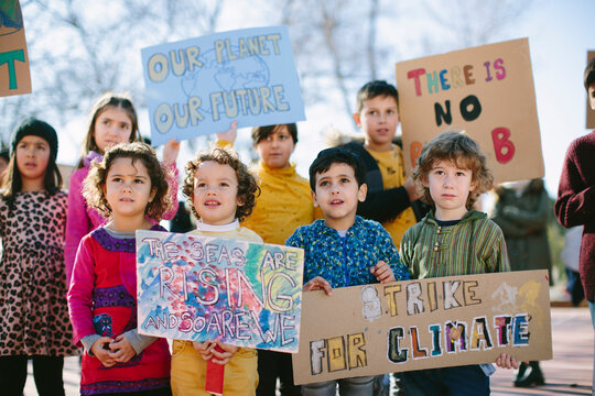 Group of young kids carrying banners