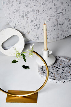 Candle stick with white marble and bronze flower circle.