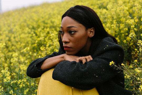 pensive black woman in flowery land