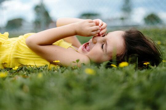 Kid lying on grass