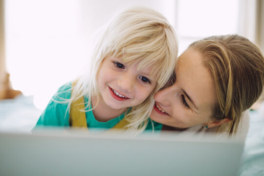 Mother and daughter with a laptop