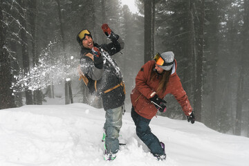 Couple having fun during a day on the snow