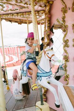 Kid on carousel