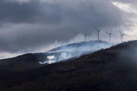 firefighting helicopter, wildfire and windmills