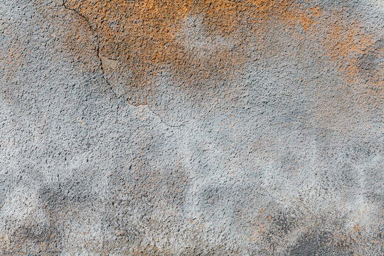 Texture of rusty oxidized stucco wall