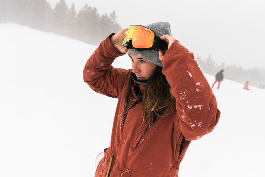 Woman having fun during a day on the snowboard
