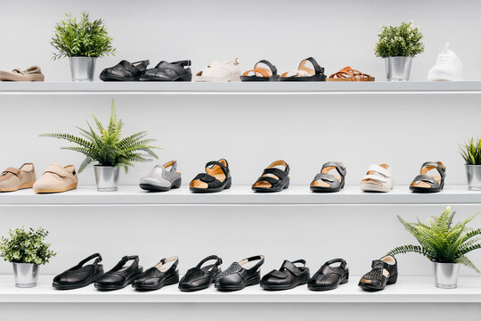 Shelves with orthopedic shoes in pharmacy
