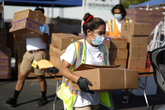 Los Angeles Food Bank volunteers hand out boxes of produce in Montebello