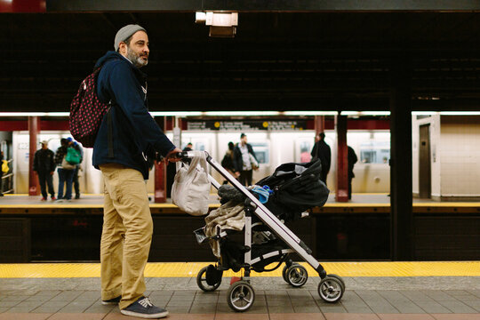 Man with stroller in the subway
