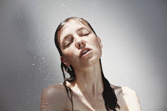 Young sensual woman in shower, Rain