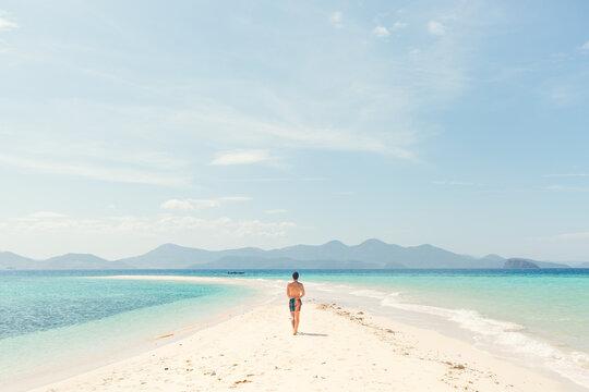 A man walking down a sand bank