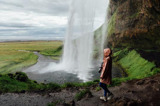 Woman standing by the Seljalandsfoss