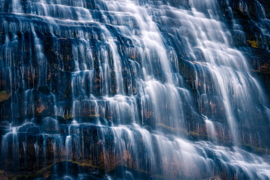 Picturesque scenery of cascade waterfall with clear water in mountainous area in long exposure