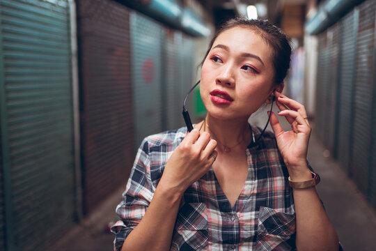 Woman with headset standing in underground corridor
