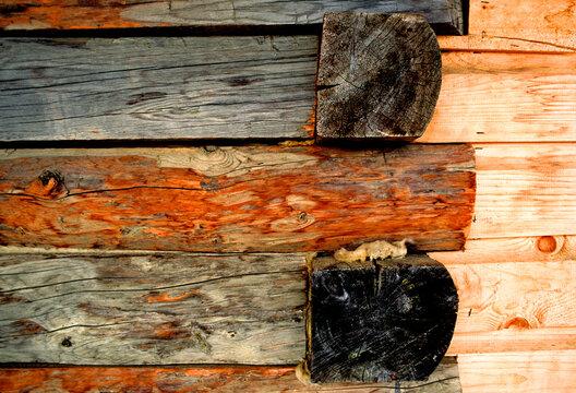 Spray foam insulation fills gaps in log cabin, Dawson City, Yukon Territory, Canada
