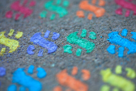 Colored stenciled chalk dollar signs on the pavement - sidewalk chalk