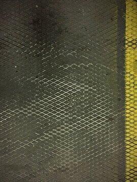 Overhead shot of metal ground in industrial elevator