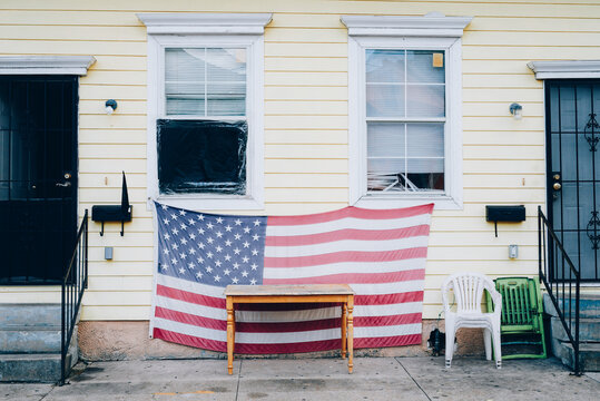 American Flag hanging on house