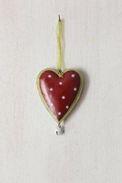 Tin heart hanging on wood