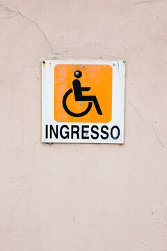 Entrance Wheelchair sign on the wall in Italian
